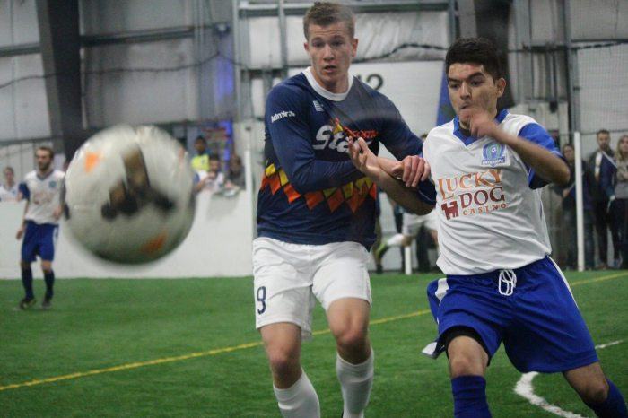 Derek Johnson (center) chases the ball in a recent match at Oly Town. Johnson's five goals and an assist last week in Wenatchee have earned him POTW honors in the WISL. (Kathy Johnson photo)