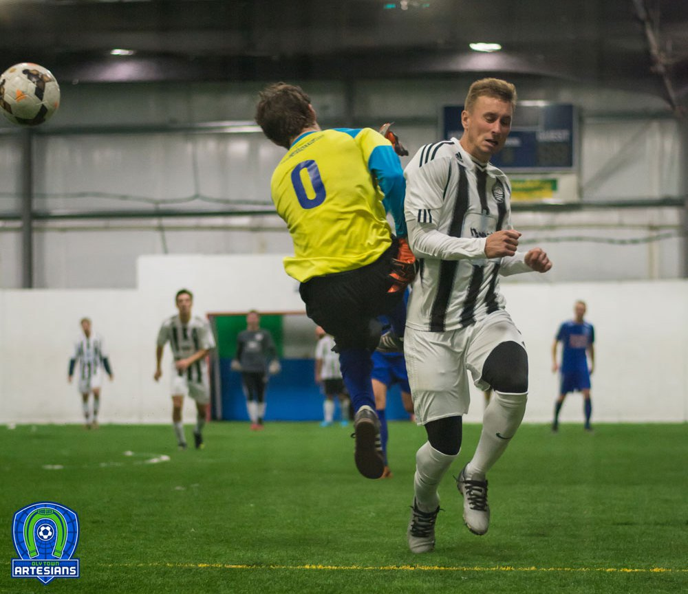 Route One: Nick Cashmere brushes against Oly Town goalkeeper.(Claris Wilson)
