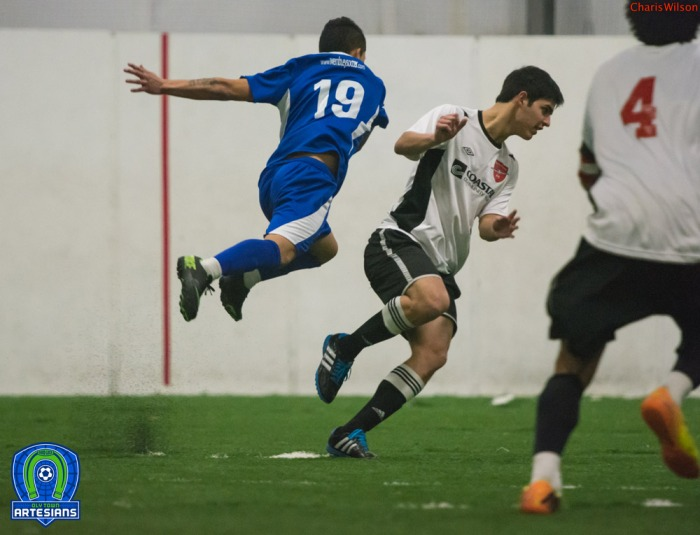 #19 for Oly Town William Ramirez flies in pursuit of the ball. His two goals on the night earn him Co-Player of the Week honors in the WISL. (Charis Wilson)